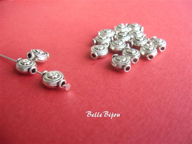 Distantier metalic argintiu antichizat cu floricica aprox 5x8x10 mm