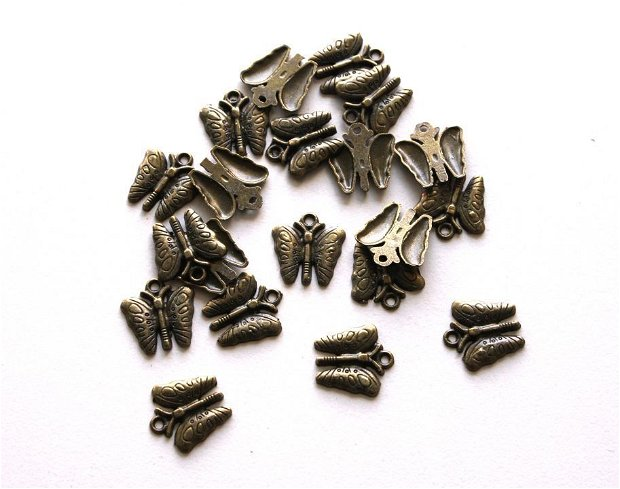 Charm bronz antic, fluturasi