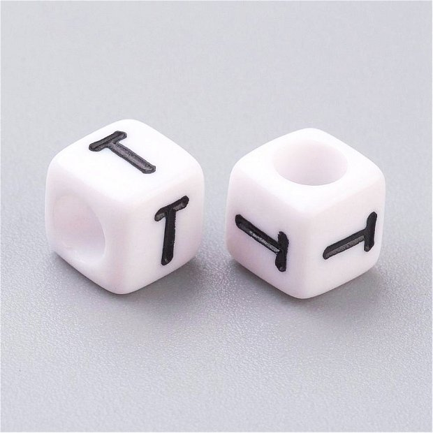 Alfabet, margea litera T cub- 67S