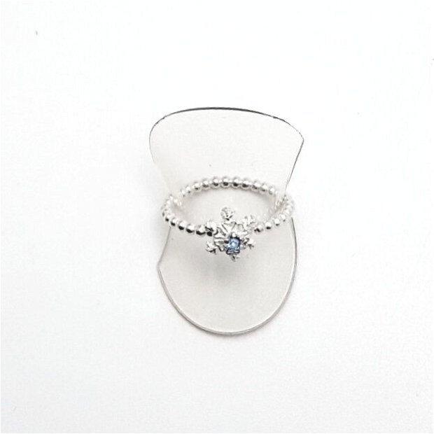 Inel din argint fin, in forma de fulg, cu un cristal Swarovski bleu
