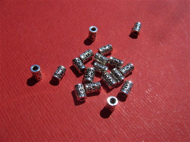 Tub din argint .925 partial antichizat aprox 5x3 mm