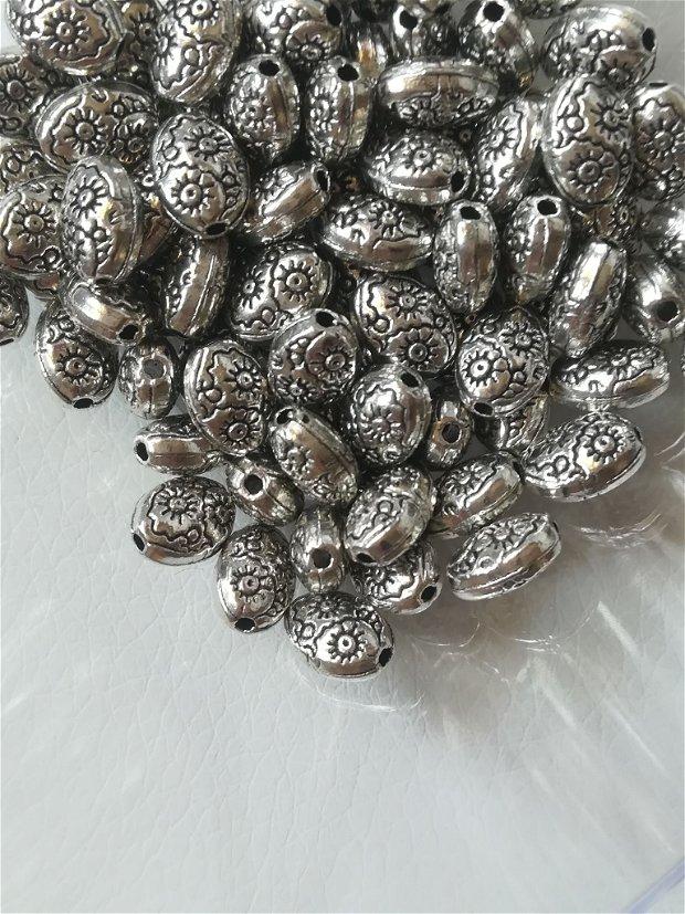 Distantier bob orez cu flori 8x6mm, argintiu - 1 buc